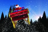 Santa flying his sleigh against snow falling on fir tree forest