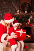 ������, ������: Mother and son near Christmas fireplace