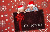 Young festive couple against gift card with festive bow