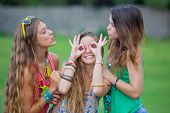 playful teen girls goofing