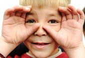 Kid with finger around the eyes