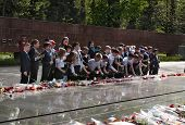 Schoolchildren Put Flowers To The Eternal Fire At The Memorial