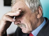 Senior depressed businessman thinking about worries