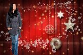 Woman standing and looking away against blurred christmas background