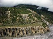 Himalayan Plateau Behind A River Delta