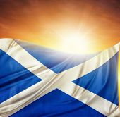 Scottish flag in front of bright sky