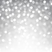 Silver defocused christmas background. Bright bokeh. Vector illustration.