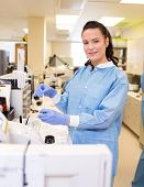 Portrait of beautiful researcher experimenting in laboratory