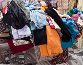 pic of thrift store  - used clothes being given to consignment store to resell and recycle - JPG
