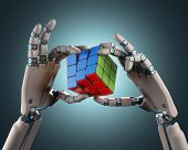 picture of robot  - Robotic hand holding a colorful cube - JPG