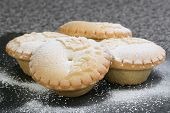 pic of desert christmas  - four christmas mince pies dusted with icing sugar - JPG