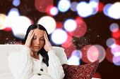 Woman suffering from a migraine against blurred lights