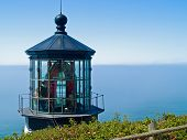 stock photo of mear  - Cape Meares Lighthouse on the Oregon Coast on a Clear Sunny Day - JPG