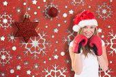 Festive blonde with boxing gloves against snowflake wallpaper pattern