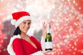 Woman holding a champagne bottle against blurred lights