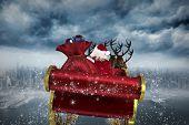 Santa flying his sleigh against coastline and city