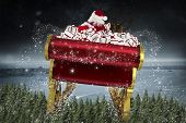 Santa flying his sleigh against balcony overlooking coastline at night