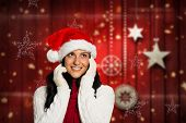 Woman looking in the distance against blurred christmas background