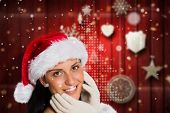 Woman smiling at the camera against blurred christmas background