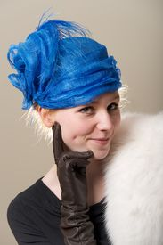 stock photo of cheeky  - Cheeky redhead in hat with leather glove - JPG