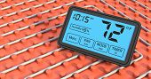 pic of floor heating  - close up view of a floor heating system with a programmable thermostat fahrenheit  - JPG