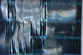 stock photo of fin  - Abstract detail of the exterior of an air conditioning unit showing damage to the fins - JPG