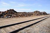 Scrap Metal Pile by Railroad Line in Alaska
