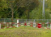 image of dirt road  - No trespassing sign at along a dirt road - JPG