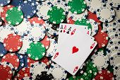 foto of poker hand  - four of a kind poker hand Aces and many chips