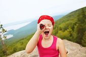 image of spyglass  - funny little girl in a bandana with a spyglass - JPG