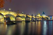 picture of old bridge  - Charles Bridge and Old Town bridge tower at night in Prague - JPG