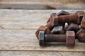 pic of bolt  - Old bolts or dirty bolts on wooden background - JPG