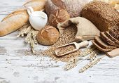 stock photo of ear  - Bakery Bread.Various Bread and Sheaf of Wheat Ears Still-life