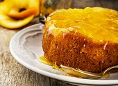 pic of upside  - Orange Upside Down Cake with vanilla and honey on wooden background - JPG