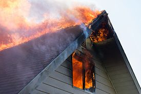 pic of gable-roof  - Close view of flames in an upper story window and running across the roof ridge - JPG