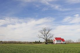 pic of red siding  - Rural church with white siding and red roof in open field - JPG