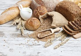 foto of fresh slice bread  - Bakery Bread.Various Bread and Sheaf of Wheat Ears Still-life ** Note: Shallow depth of field - JPG