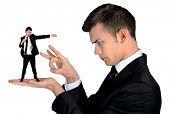 picture of nervous breakdown  - Isolated business man finger flipping on little man - JPG
