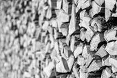 pic of firewood  - Closeup of chopped firewood in a stack ready for burning in monochrome - JPG