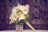 pic of arum lily  - Capture of Elegant lily bouquet on table - JPG