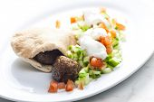 stock photo of meatball  - meatball in pan pita with tomato and cucumber salad - JPG