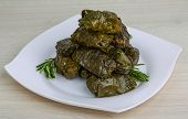 stock photo of grape leaf  - Greek dolma in grape leaves with meat served rosemary - JPG
