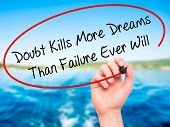 picture of kill  - Man Hand writing Doubt Kills More Dreams Than Failure Ever Will with black marker on visual screen - JPG