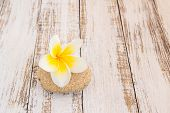 image of stone-therapy  - Tropical Plumeria and stone therapy on wooden table for spa and wellness concept - JPG