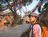stock photo of buddhist  - A man near the Buddhist stupa  - JPG