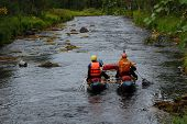 foto of raft  - Two men on a catamaran raft down the taiga river - JPG