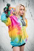 picture of nose ring  - Blond skater girl holding skateboard - JPG