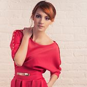 stock photo of young woman posing the camera  - Beautiful young fashionable woman posing in red dress - JPG