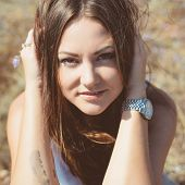 image of jeans skirt  - Portrait of beautiful young woman which sits on grass on natural background - JPG
