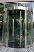 stock photo of revolver  - Modern revolving door as entrance to office building or hotel - JPG
